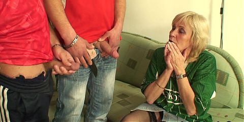 Skinny blonde granma swallows two cocks at once